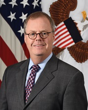 Official photo of Mr. Tom McCaffery, the Assistant Secretary of Defense for Health Affairs