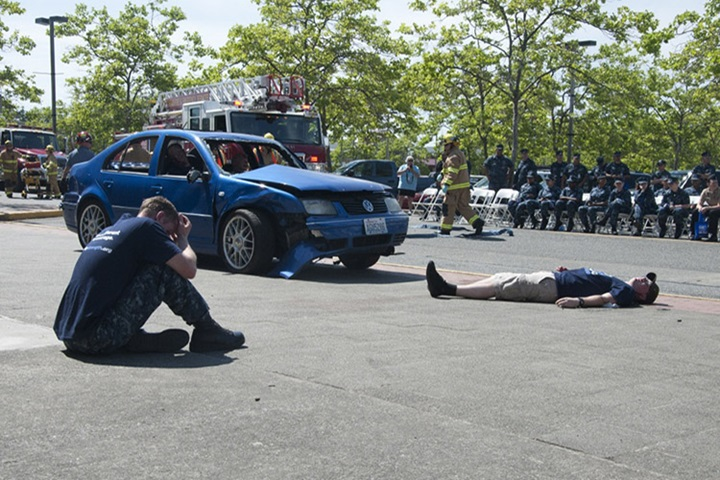 Sailors simulate a drunk driving accident during a Keep What You've Earned fair on Naval Base Kitsap Bangor. The fair encourages responsible alcohol use by celebrating the achievements in the sailors' Navy careers and actively engages sailors as advocates for responsible drinking. (U.S. Navy photo by Mass Communication Specialist 3rd Class Chris Brown)