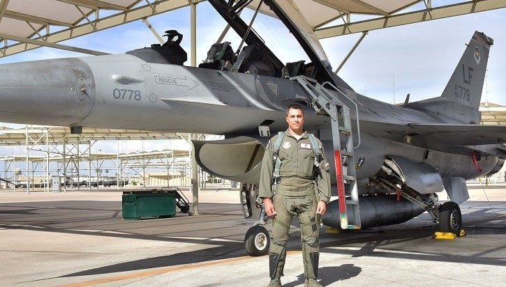 Air Force Lt Col stands by F-16 fighter jet.