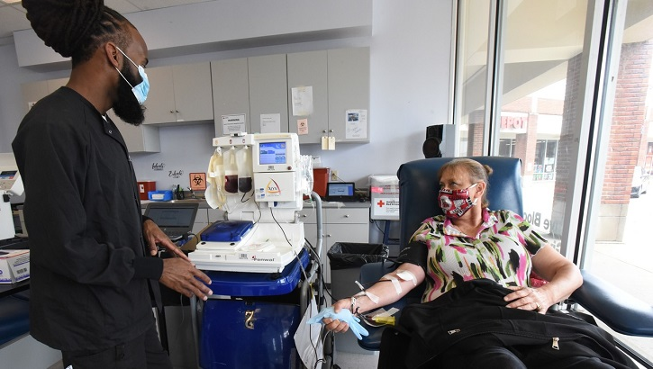 Woman sitting in chair giving blood