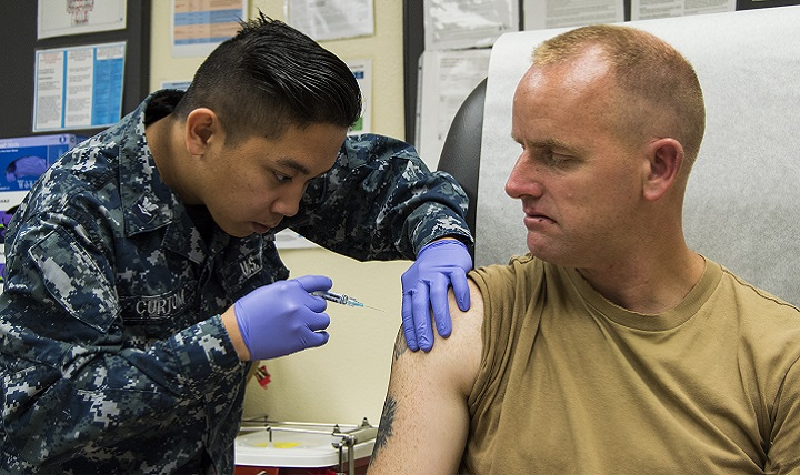 Navy Hospital Corpsman 3rd Class Gerich Curtom (left), administers a flu shot to Builder 2nd Class Charles Scheck at Naval Air Station North Island's medical clinic. There are many different strains of flu virus, and they can often mutate quickly, presenting a challenge in keeping everyone healthy and maintaining optimal immunity, and making it necessary to get immunized annually. (U.S. Navy photo by Mass Communication Specialist 1st Class Sean P. Lenahan)
