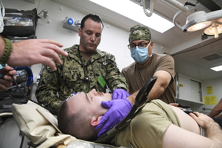 Service members assigned to Expeditionary Resuscitative Surgical System 19 prepare medical supplies aboard Royal Fleet Auxiliary ship Cardigan Bay during exercise Azraq Serpent 18. (U.S. Navy photo by Mass Communication Specialist 2nd Class Kevin J. Steinberg)