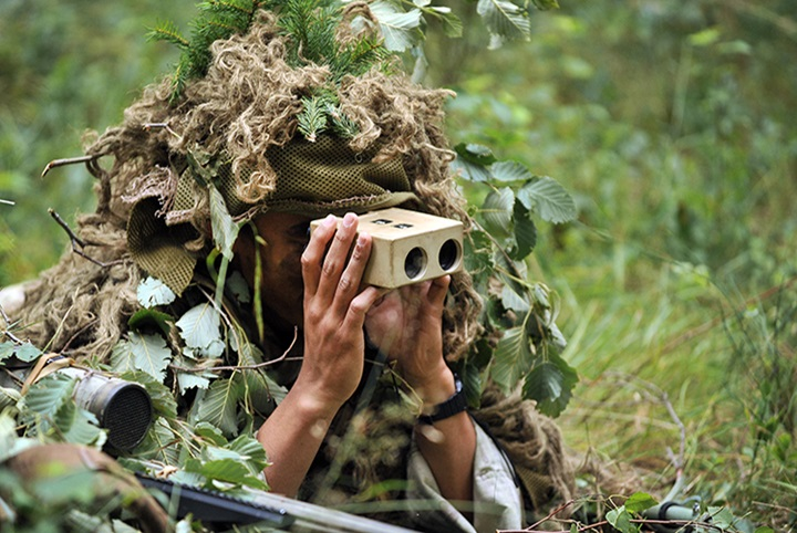 A paratrooper with 1st Squadron, 91st Cavalry Regiment, 173rd Airborne Brigade lies concealed in a forest and observes his target during a combined sniper exercise with the British Army's 1st Battalion, Royal Irish Regiment as part of Exercise Wessex Storm at the 7th Army Joint Multinational Training Command's Grafenwoehr Training Area, Germany, July 30, 2015. Wessex Storm is an annual maneuver exercise for British forces, integrating NATO allies and partners. (U.S. Army photo by Visual Information Specialist Gertrud Zach/released)