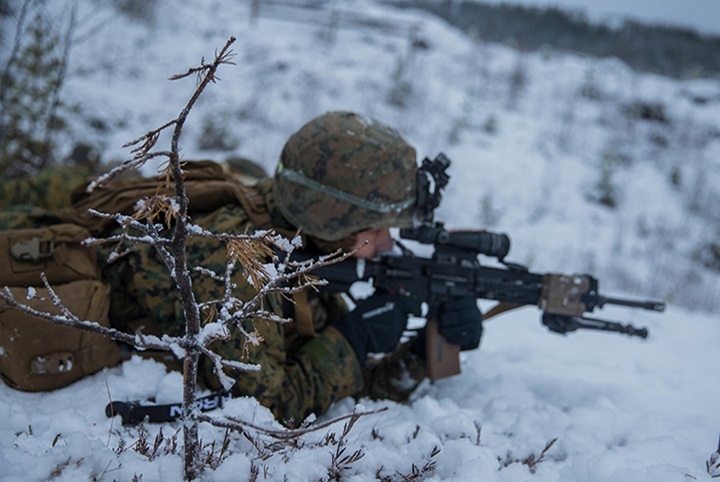A U.S. Marine with Marine Rotational Force-Europe (MRF-E) 19.1 maintains a defensive security position during Exercise Winter Warrior in Haltdalen, Norway, Dec. 5, 2018. The three-week exercise tested the Marines' abilities to adapt to harsh weather conditions, move across long distances in the snow and push themselves to complete the mission despite austere situations. (U.S. Marine Corps photo by Cpl. Elijah Abernathy/Released)