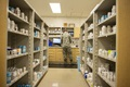 U.S. Air Force Tech Sgt. Ryan Marr, 18th Medical Group pharmacy craftsman, processes prescriptions, June 8, 2018, at Kadena Air Base, Japan. The pharmacy processes and fills prescriptions for hundreds of different medical needs. (U.S. Air Force photo by Staff Sergeant Jessica H. Smith) Merriam/Released)
