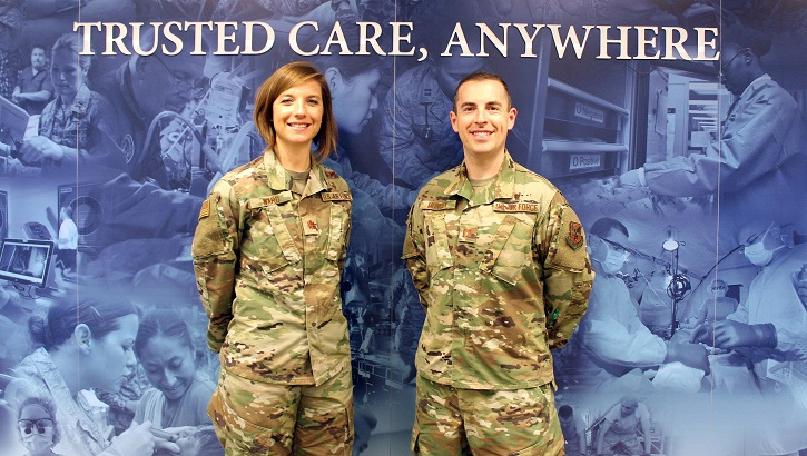 Air Force Maj. Nicole Ward (left) and Air Force Capt. Matthew Muncey, program managers with the Air Force Medical Service Transition Cell, pose for a photo at the Defense Health Headquarters in Falls Church, Virginia. (U.S. Air Force photo by Josh Mahler)
