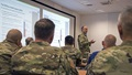 Air Force Maj. Gen. Lee E. Payne. DHA assistant director for combat support, talks to attendees of the 2019 U.S. Africa Command Command Surgeon Synchronization Conference May 28, 2019 in Stuttgart, Germany. Payne discussed upcoming changes to the military health system and what that means for patients and providers. (U.S. Navy photo by Mass Communication Specialist 1st Class Christopher Hurd/Released)