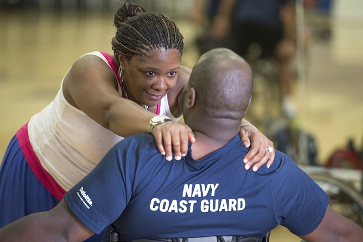 Shundra Johnson, left, gives encouragement to her husband Coast Guard Lt. Sancho Johnson during the Navy's wounded warrior training camp for the 2015 DoD Warrior Games in Port Hueneme, Calif., May 29, 2015. Shundra is also her husband's caregiver. (DoD News photo by EJ Hersom)