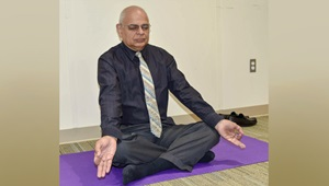 aac741674b Dr. Bhagwan Bahroo, staff psychiatrist, demonstrates a deep-breathing  posture as he
