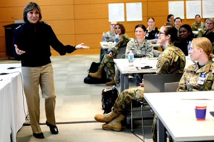 Navy Vice Admiral Raquel Bono, DHA director, interacts with attendees of the Female Physician Leadership Course during a presentation April 1, 2019. (MHS photo)