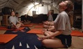 Airmen and Soldiers practice breathing and relaxation during their off duty time in a deployed location. Stress can take its toll on your mental and physical health, including your heart health, but there are breathing techniques to buffer yourself from it. (U.S. Air Force photo by Master Sgt. Lance Cheung)