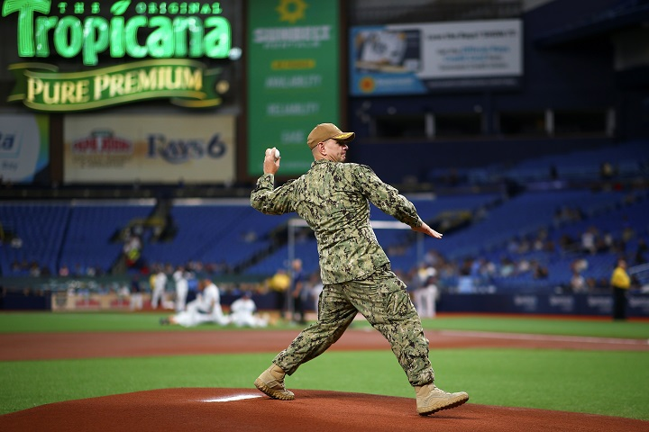 Navy Cmdr. Coby Croft throws out the first pitch at the invitation of the Tampa Bay Rays baseball team as they took on the Arizona Diamondbacks on May 6. Croft was invited as part of this year's National Nurses Week celebration, which continues until May 12. (Photo courtesy of the Tampa Bay Rays.)