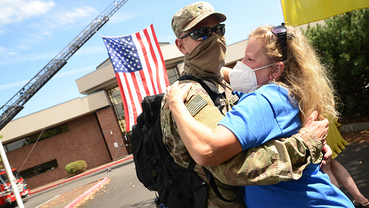 Military husband hugging his wife