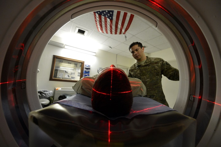 An Army medic positions a patient for a CT scan, which helps radiologists diagnose different types of disease and injuries. Medical devices, such as radiology imaging systems, must now go through a cybersecurity validation process in order to connect to military networks (U.S. Army photo by Staff Sgt. Evelyn Chavez)