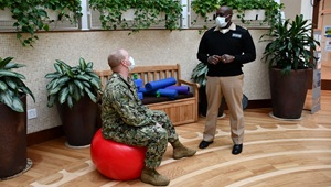 Military personnel wearing face mask while talking to each other