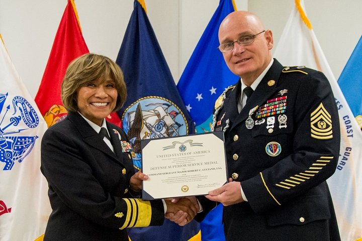 Army Command Sgt. Maj. Robert Luciano receives the Defense Superior Service Medal at the Defense Health Agency's Change of Responsibility ceremony. (MHS photo)
