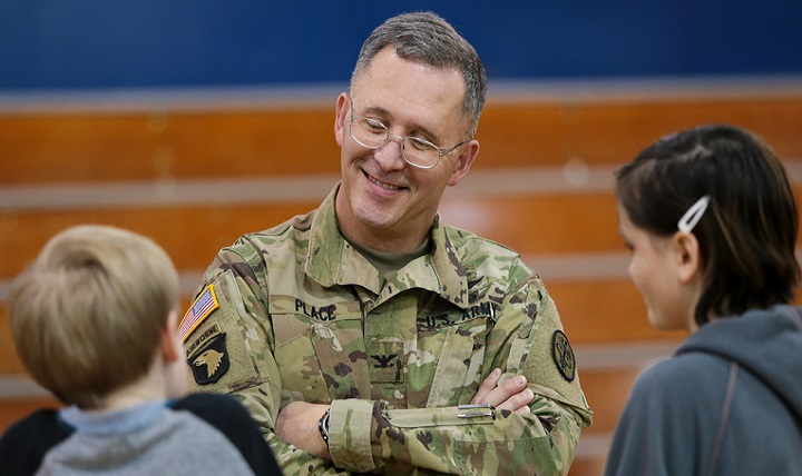 Army Col. Michael Place, commander of Madigan Army Medical Center at Joint Base Lewis-McChord, Washington, discusses school-based health with youngsters. (Courtesty photo )