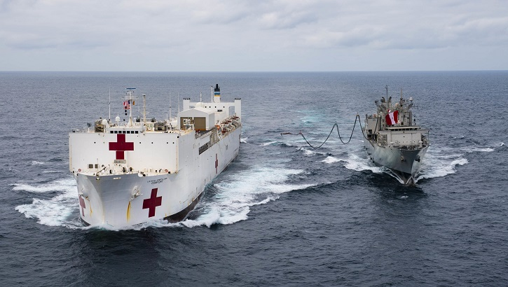 The hospital ship USNS Comfort (left) receives a fuel probe from the Peruvian ship B.A.P. Tacna during replenishment-at-sea practice. Comfort is working with health and government partners in Central America, South America, and the Caribbean to provide care on the ship and at land-based medical sites, helping to relieve pressure on national medical systems strained by an increase in Venezuelan migrants. (U.S. Navy photo by Mass Communication Specialist 2nd Class Morgan K. Nall)