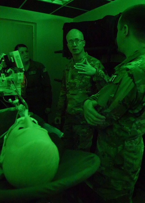 Army Maj. Gen. Ronald Place, Defense Health Agency, director for the National Capital Region Medical Directorate and Transition Intermediate Management Organization, discusses the benefits of the critical care air transport team simulation lab created to train for real world scenarios with U.S. Air Force Staff Sgt. Nicole Richards, 81st Medical Operations Squadron CCATT NCO in charge, and Capt. Thomas Ross, 81st Inpatient Operation Squadron officer in charge, during an immersion tour inside the Keesler Medical Center at Keesler Air Force Base, Mississippi. (U.S. Air Force photo by Kemberly Groue)