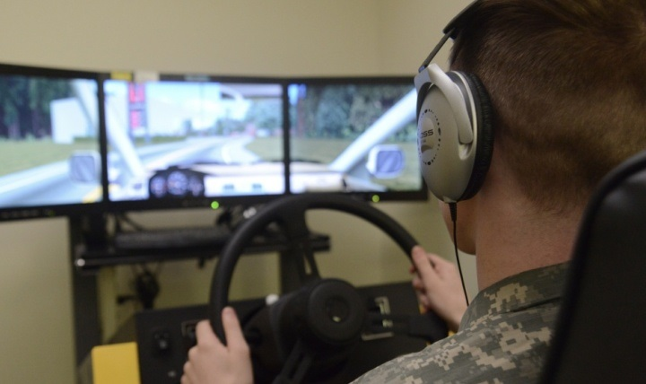 A soldier at Joint Base Elmendorf-Richardson's traumatic brain injury clinic in Alaska takes a cognitive hand-eye coordination test on a driving stimulator.