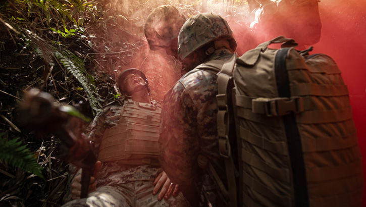 Okinawa, Japan (June 7, 2019) Hospital corpsmen respond to a simulated patient casualty during a tactical combat casualty care exercise as part of a rigorous Jungle Medicine Course at Jungle Warfare Training Center, Okinawa, Japan. The 10-day course trains Navy medical personnel assigned to Marine forces on jungle survival skills, patient tracking, field medical care, and casualty evacuation techniques. (U.S. Navy photo by Mass Communication Specialist 2nd Class Jeanette Mullinax)