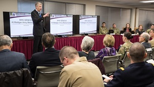 Chris Gruber, the MHS GENESIS project officer for the Regional Health Command -- Pacific, offers a demonstration of the Department of Defense's new electronic health record, MHS GENESIS, to the Defense Health Board as they visit Madigan Army Medical Center on Joint Base Lewis-McChord, Wash., on Nov. 5. (Photo Credit: John Wayne Liston (Madigan Army Medical Center) )