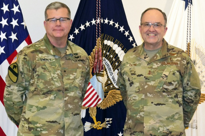 Army Brig. Gen. Mark Simerly , DLA Troop Support commander, left, poses with Air Force Maj. Gen. Lee Payne, DHA's Combat Support Agency assistant director, right, during a visit Jan. 11, 2019 in Philadelphia. DLA Troop Support hosted Payne to discuss current support operations and plans as DHA assumes management and administration of military treatment facilities. (DoD photo by Shaun Eagan)