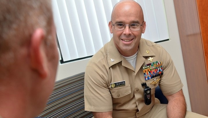 Image of naval captain talking to another military person