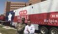 After working together in the aftermath of Hurricane Harvey, Army Master Sgt. Dean Dawson meets again with brother-in-law and chef Albert Rodriguez during the Invincible Spirit Festival at Brooke Army Medical Center, Joint Base San Antonio. (Courtesy photo)