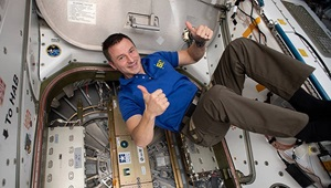 Flight Engineer Drew Morgan of NASA is pictured in the vestibule between the Unity module and the Northrop Grumman Cygnus space freighter shortly after its hatch was closed. Morgan was selected by NASA in 2013 as an astronaut candidate after serving in the Military Health System as an emergency physician with special operations units worldwide.  (NASA photo, Editor: Victoria Ugalde)