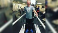Man walking with assistance at a PT clinic