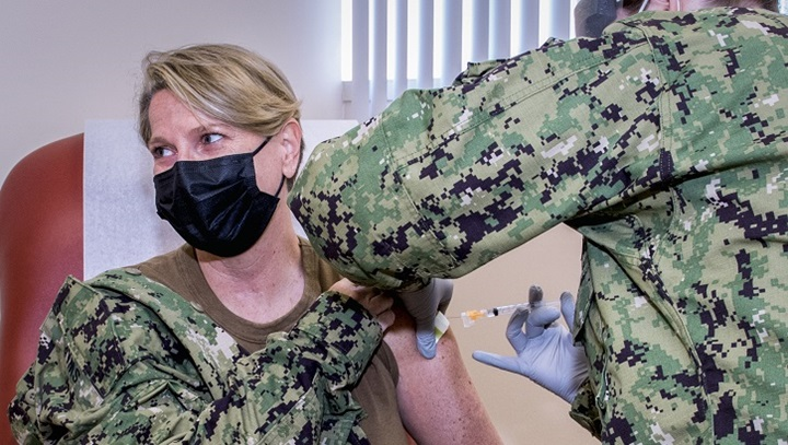 Military personnel getting flu shot