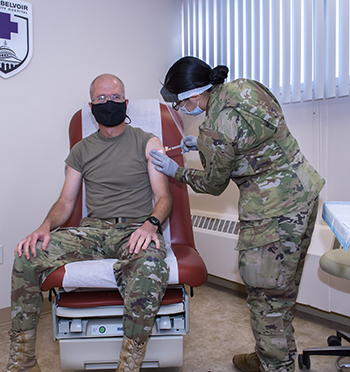 Army Lt. Gen. Ronald Place getting his flu vaccine