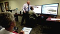 Charles Cumiskey and Lt. Col. Sherie Johnson show charge nurses at Madigan Army Medical Center some of the finer points of Clairvia on Sept. 17. Clairvia is a workload management tool in MHS GENESIS. (Photo Credit: Suzanne Ovel)