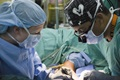 Army Maj. Elizabeth Polfer (left), an orthopedic surgeon at William Beaumont Army Medical Center in Texas, performs hand surgery with her Honduran counterpart in Tegucigalpa, Honduras, during a Regional Health Command-Central Global Health Engagement Medical Readiness Training Exercise. (U.S. Army photo by Maria Pinel)