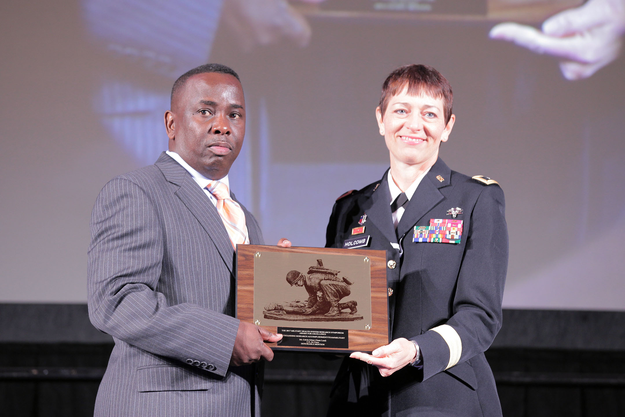 Major General Barbara R. Holcomb, commanding general of the U.S. Army Medical Research and Materiel Command, presented Calvin Griner and his research team from the Air Force Medical Service with the 2017 Team Research Accomplishment (Military), in the category of Advanced Development, on Aug. 28 at the Military Health System (MHS) Research Symposium. The team received honorable mention for their work in developing the Multiple-Channel Negative Pressure Wound Therapy Device—a device capable of treating four wounds simultaneously.