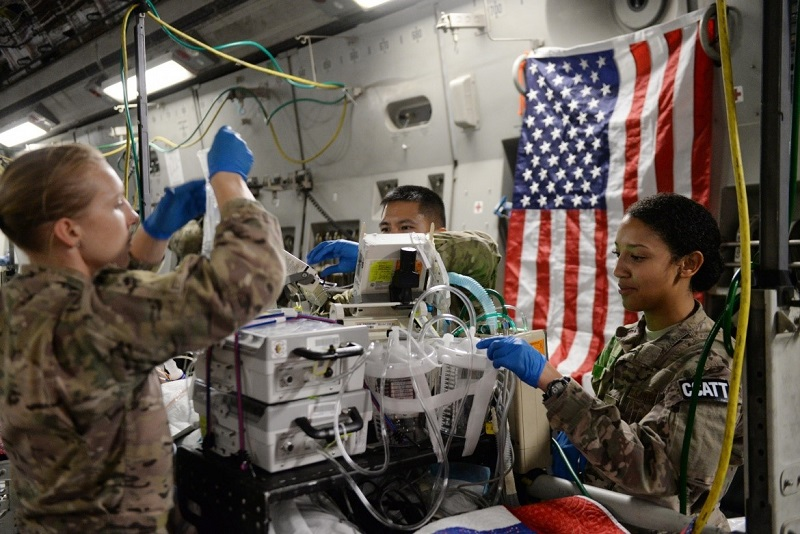 Image of medical personnel preparing surgical technology
