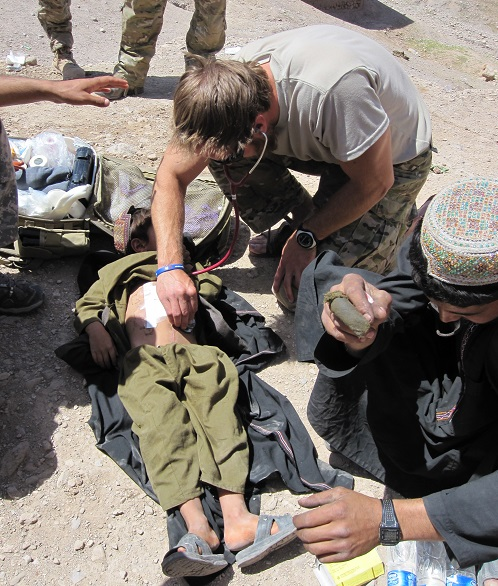 A young Afghan boy was injured by shrapnel in his village. Army Sgt. 1st Class Philip Nordstrom treated the boy after he was injured. (Photo courtesy of Philip Nordstrom)