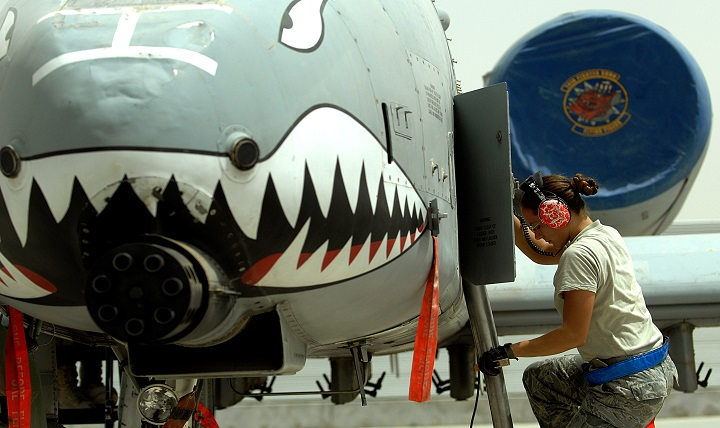 U.S. Air Force Senior Airman Judith Bulkley, an electrical and environmental systems specialist deployed from the 23rd Aircraft Maintenance Squadron, Moody Air Force Base, Ga., exits an A-10C Thunderbolt II after performing an external power operations check on the aircraft at Kandahar Airfield, Afghanistan. Because service members in particular are often exposed to high noise levels, hearing protection is crucial, especially with a TBI. (U.S. Air Force photo by Tech. Sgt. Stephen Schester)