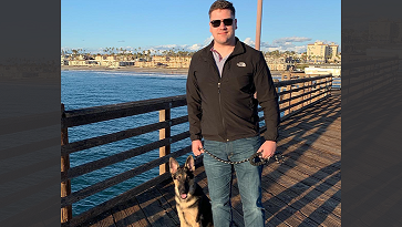 Petty Officer 3rd Class Logan Talbott gets exercise and fresh air when taking dog Odin on long walks. Here, they're at Oceanside Pier in California. (Courtesy photo)