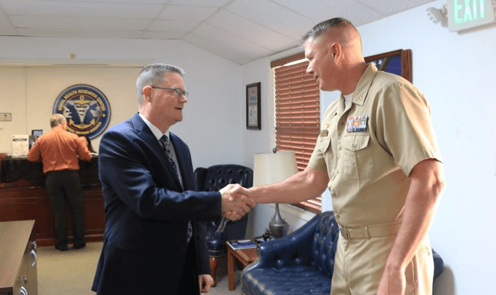 SAN DIEGO (Oct. 25, 2017) The Defense Health Agency's (DHA) acting director for Research and Development, Sean Biggerstaff, left, is greeted by Naval Health Research Center (NHRC) commanding officer, Capt. Marshall Monteville, right, during a recent visit to the command. Biggerstaff is responsible for prioritizing and integrating DHA medical research, development, and acquisition programs across the Military Health System. His directorate also fosters strategic partnerships and transitions medical discoveries to deployable products to enhance the readiness of the military community. During the visit, Biggerstaff learned how NHRC's mission aligns with DHA's priorities to improve the health and readiness of U.S. warfighters. (U.S. Navy photo by Regena Kowitz/Released)