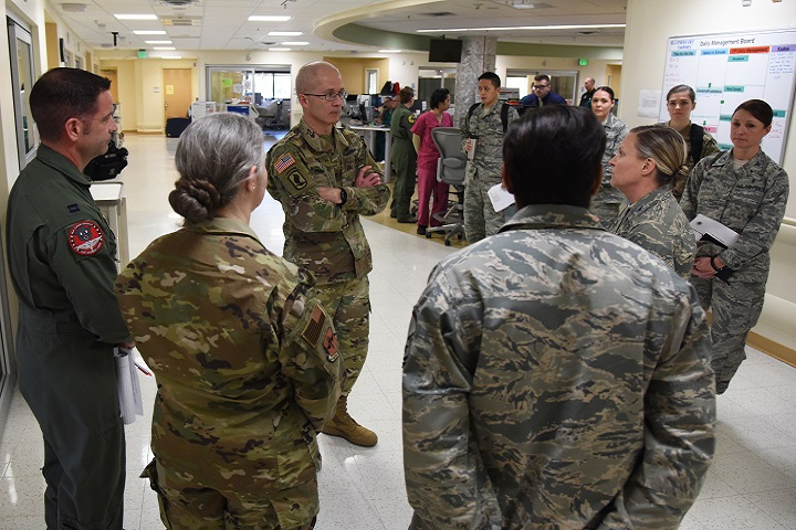Air Force Col. Michelle Aastrom, 81st Inpatient Operation Squadron commander, discusses the intensive care unit capabilities with Army Maj. Gen. Ronald Place, Defense Health Agency, director for the National Capital Region Medical Directorate and Transition Intermediate Management Organization, during an immersion tour inside the Keesler Medical Center at Keesler Air Force Base, Mississippi, Feb. 13, 2019. The purpose of Place's two-day visit was to become more familiar with the medical center's mission capabilities and to receive the status of the 81st Medical Group's transition under DHA. (U.S. Air Force photo by Kemberly Groue)