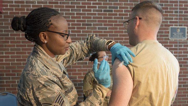 Air Force Staff Sgt. Jaqueline Mbugua and members of the Massachusetts Air National Guard's 102nd Medical Group traveled to the Roxy Theater on Joint Base Cape Cod to provide flu shots to Airmen Nov. 2, 2019. (U.S. Air Force photo by Tech. Sgt. Thomas Swanson).