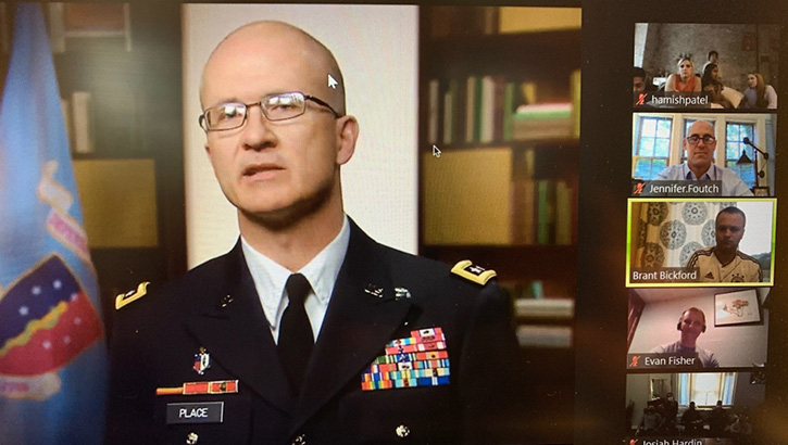 Image of Lt. Gen. Place with other people's monitors around him on a Zoom call