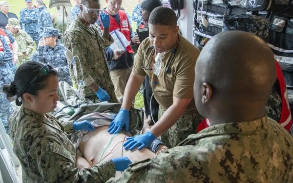 U.S. Airmen assigned to the 455th Expeditionary Medical Group perform trauma surgery on a gunshot victim at the Craig Joint Theater Hospital, Bagram Air Field, Afghanistan.
