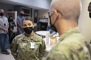 Senior Airman Jessica McVean briefs Army Lt. Gen. Ronald Place,
