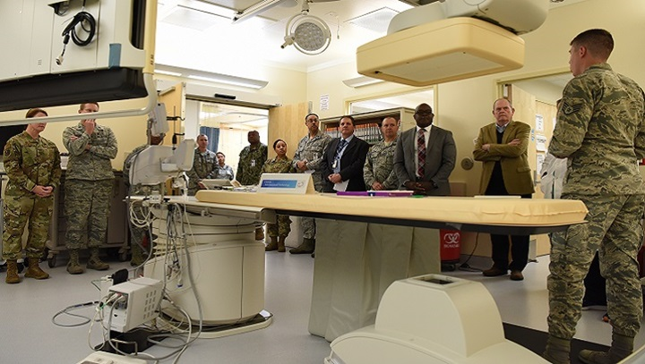 Air Force Staff Sgt. Matthew Slaven (right), 81st Medical Operations Squadron cardiopulmonary technician, briefs 81st Medical Group staff and guests on cath lab capabilities during the cardiac catheterization laboratory ribbon cutting ceremony inside Keesler Medical Center at Keesler Air Force Base, Mississippi. The lab was upgraded with an entire suite of technology to provide better and safer care for patients and the surgical team. (U.S. Air Force photo by Senior Airman Suzie Plotnikov)