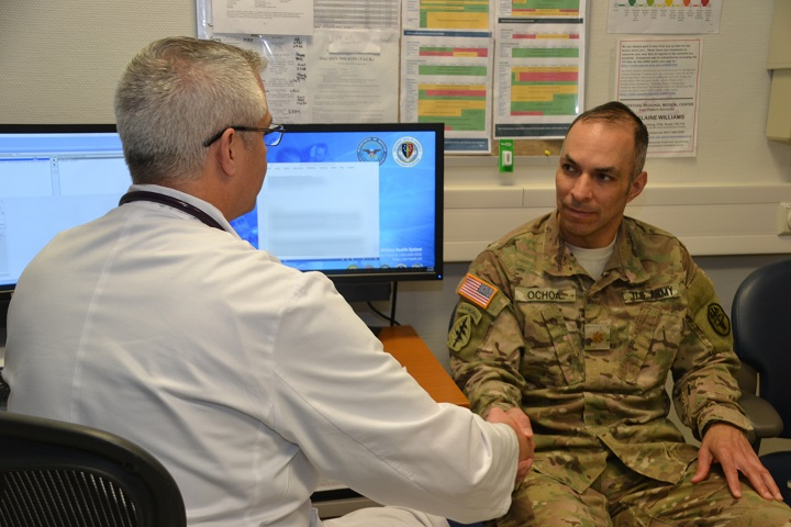 Dr. Michael Kennedy (left), a family medicine provider at Landstuhl Regional Medical Center, discusses the importance of proactive health readiness with Army Maj. Oscar Ochoa. With a focus of preventive prostate screening, healthy eating and physical fitness, Kennedy emphasized the importance of men to stay engaged in their health care and not to wait until the last minute to be seen by a primary care provider. (U.S. Army photo by Stacy Sanning)