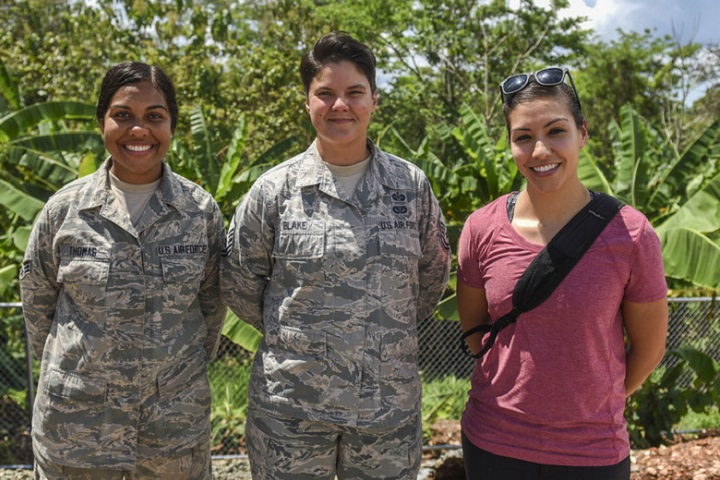 From left to right: U.S. Air Force Senior Airman Ariel Thomas, 346th Air Expeditionary Group medical technician, Master Sgt. Reina Blake, 346 AEG Office of the Legal Advisor superintendent, and Special Agent Alexandra Garced, Air Force Office of Special Investigations agent, stand for a group photo in Meteti, Panama. Blake, Thomas and Garced are credited with saving the life of a local Panamanian woman after she jumped from a bridge. (U.S. Air Force photo by Senior Airman Dustin Mullen)