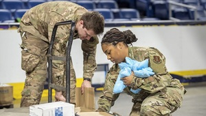 Image of two soldiers organizing medical supplies